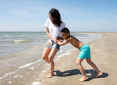Mother and son playing at the beach  — Stock Photo