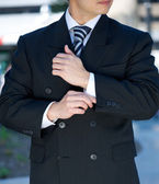 Businessman adjusting cuff  — Stock Photo