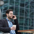 Man sitting in the city with mobile phone — Stock Photo #48412419