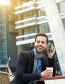Man laughing with mobile phone — Stock Photo