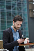 Sending text message on mobile phone — Stock Photo