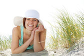 Beautiful young woman smiling with hat — Stock Photo