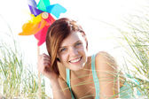 Young woman smiling outdoors — Stock Photo
