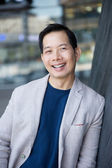 Cool middle aged asian man smiling — Stock Photo