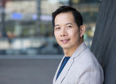 Handsome middle aged asian man — Stock Photo