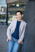Smiling asian man posing outdoors — Stock Photo