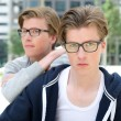 Young adult male twins posing outdoors — Stock Photo