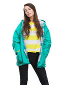 Young woman posing in green raincoat — Stock Photo