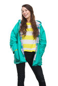Young woman smiling with raincoat — Stock Photo
