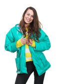 Young woman smiling with green raincoat — Stock Photo