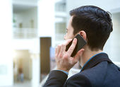 Young business talking on mobile phone — Stok fotoğraf