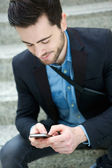 Young man sending text message — Stock Photo