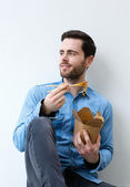 Cool guy eating chinese take away food — Stock Photo
