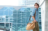 Portrait of a trendy young man walking — Stock Photo