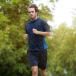 Man jogging outdoors in the forest — Stock Photo #50261625