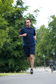 Full body of a young man jogging  — Stock Photo