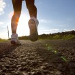 Woman running on road in sneakers — Stock Photo #50302961