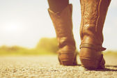 Female with cowboy boots — Stock Photo