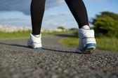 Low angle close up woman walking — Stock Photo