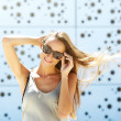 Young woman smiling with sunglasses — Stock Photo #50372915