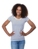 Woman with curly hair smiling with hands on hip — Stock Photo