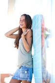 Carefree young woman standing outside — Stock Photo