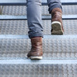 Man walking up stairs in boots — Stock Photo #51462675