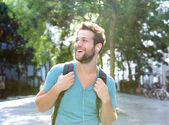 Happy young man traveling with backpack  — Stock Photo