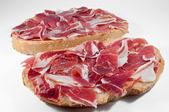 Bread with tomato and ham — Stock Photo