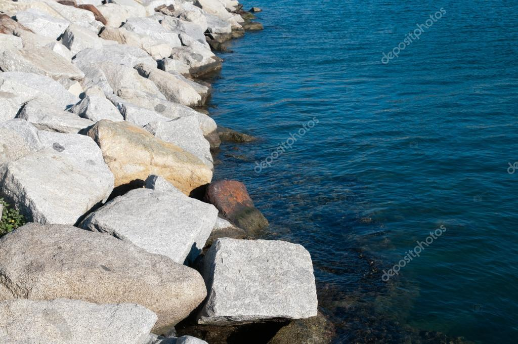 Detail of a stone breakwater consisting of quarry — Stock Photo #18215339