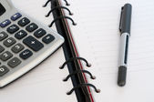 Organizer with calculator and pen — Stock Photo