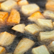Potatoes frying in oil — Stock Photo