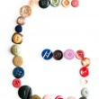 Letter alphabet formed of buttons — Stock Photo