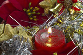 Christmas candle with poinsettia — Stock Photo