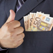 Man with money in his pocket — Stock Photo
