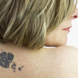 Tattoo of a woman — Stock Photo