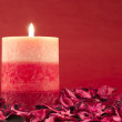 Candle on red background — 图库照片