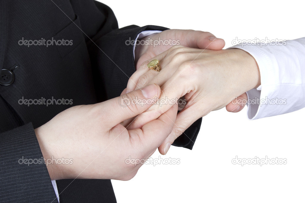 Wedding couple looking at their engagement ring on a white background.  Foto de Stock   #19539793