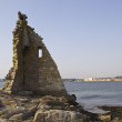 Ruined tower on the sea — Stock Photo