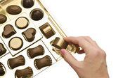 Box of chocolates on a white background — Stock Photo