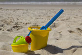 Beach bucket and watering can — Stock Photo