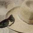 Close up of a straw hat and sunglasses — Stock Photo