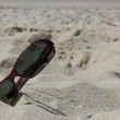 Sunglasses on the sand — Stock Photo