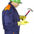 Worker looking at his hammer — Stock Photo