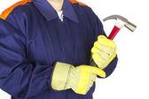 Werknemer met een hamer — Stockfoto