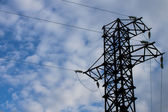 Electric high voltage tower with sky background — Foto Stock