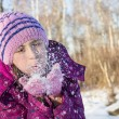 Small girl blow snow — Stock Photo