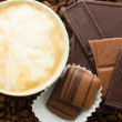 Stock Photo: Chocolate on cofee background