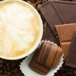 Chocolate on cofee background — Stockfoto #21424113
