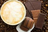 Chocolate on cofee background — Stock Photo